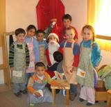 Baba Noel (Santa Claus) visits the Gan