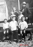 1924- on the steps of the shack in Balfour St. holding Hebrew books