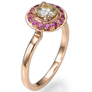 טבעת אירוסין בשיבוץ ספירים ורודות במשקל של כ 0.2 קרט נקיים לעין.