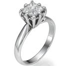 """טבעת אירוסין בשיבוץ בלתי נראה של 4 יהלומים בצורת פרינסס 0.16 קרט כל אחד בסה""""כ 0.64 קרט בצבע F וניקיון VS2."""