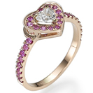 """טבעת אירוסין """"הלב שלה"""" משובצת מראש ביהלום בצורת לב במשקל 0.31 קרט בצבע F וניקיון SI1 הטבעת משובצת ב 29 ספירים ורודים במשקל 0.38 קרט נקיים לעין."""