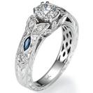 טבעת אירוסין במודל החרוט בעבודת יד אשר משובץ ב -2 ספירים כחולים ו 12 יהלומים במשקל 0.15 קרט בצבע F וניקיון SI1.