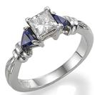 """טבעת אירוסין בסגנון """"ארט דקו"""" משובצת ב 2 ספירים כחולים בחיתוך משולש במשקל כולל של כ- 0.72 קרט ."""