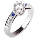"""טבעת אירוסין בסגנון """"סירקה 1910"""" הטבעת משובצת ב 6 יהלומים במשקל כולל של כ-0.2 קרט בצבע G וניקיון VS2, משובצת ב 2 אבני ספיר כחולות."""
