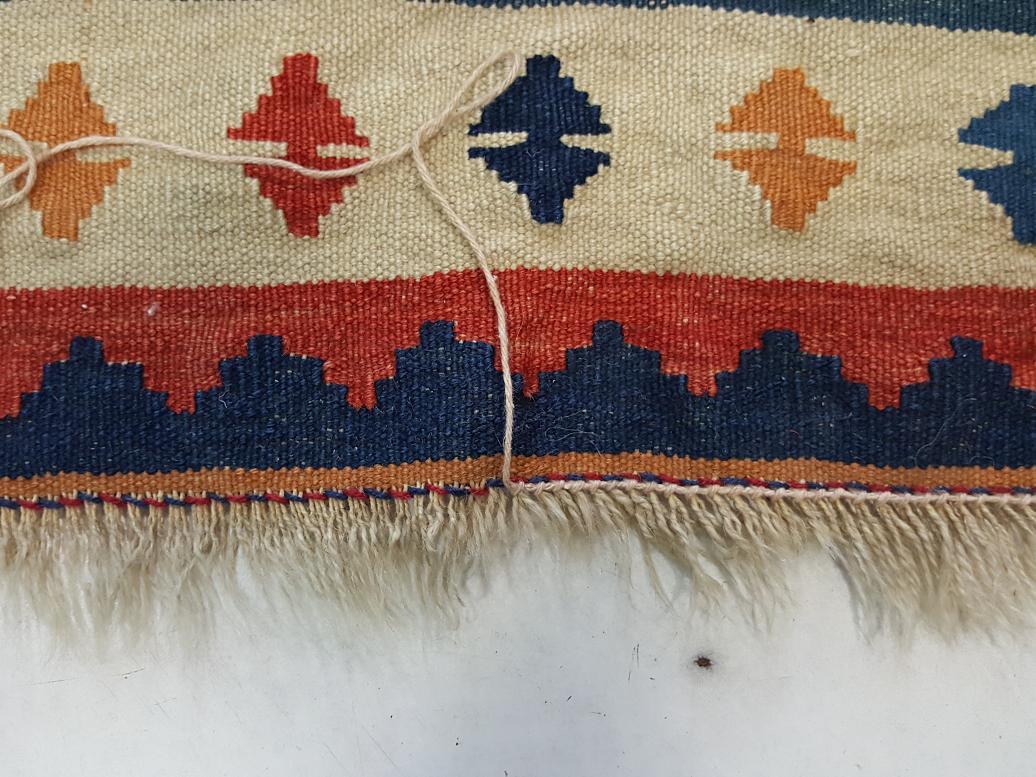 אוברלוק קשירה לשטיח קילים