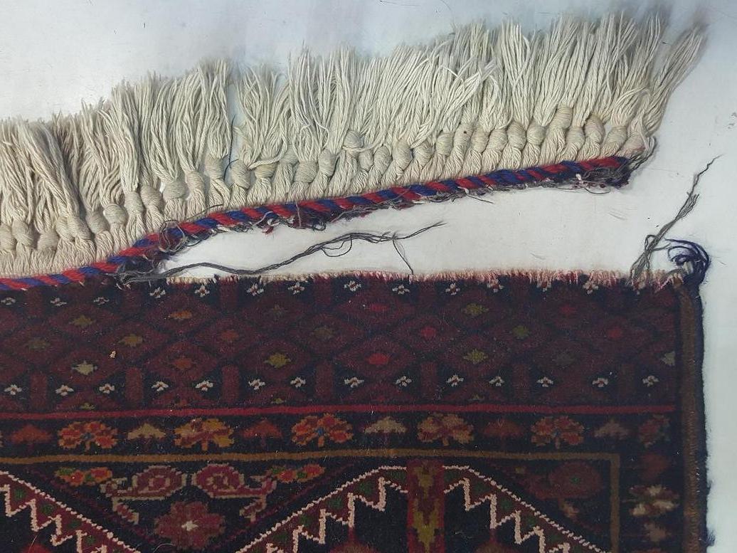 שטיח אפגני שתפרו לו פרנזים בצורה לא מקצועית