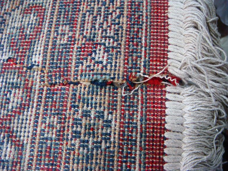 קרע בשטיח כרמל מכונה