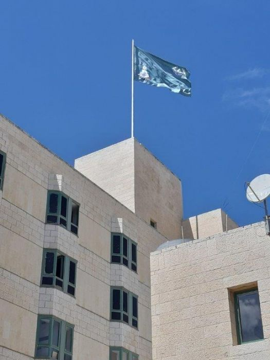 12 m steel flagpole Installation on the roof of the Jerusalem Border Patrol with 3.6 x 5 m flags