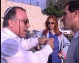 אלי סער מסביר לראש העיר לוד, פנחס עידן , למה לא צריך ועדה קרואה לעיריית לוד. ברקע, רותי חדד שאות מהיכן יגיע הכסף