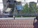 רשת חופה נגד יונים על מרפסת סוכה