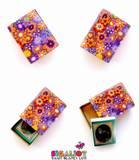 T3- ספר תהילים בתוך קופסת גפרורים- זוהי קופסת גפרורים מצופה עם יריעה של חימר פולימרי סגול ועליו 10 פרחים בכתום וסגול. על החלק העליון פזורים פרחים דו מימדיים ובמרכזם אבני קריסטל צבעוניות. פנים הקופסה צבוע באקריל זהב. מידות הקופסה הן מידות של קופסת גפרורים רגילה. (SOLD)