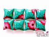 """סט של שמונה חרוזי כרית בסגנון אבן טורקיז עם פרחים אדומים. גודל החרוזים 20 מ""""מ * 20 מ""""מ. החרוזים נמכרים בסט של 8 או של 4 חרוזים. SOLD"""