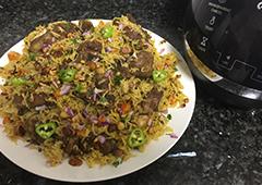 תבשיל אורז עם ירקות וצוואר טלה