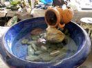 מפל מים כד נופל על אבן