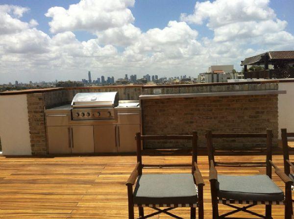 מנגל מאבן בדירת גג
