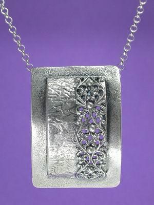 Framed filigree pendant