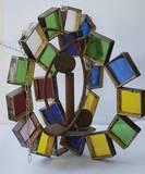 """""""שמש"""", 2004, זכוכית, ברזל, מלט, 80 ס""""מ גובה."""