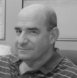 Dr. Amichai Brezner