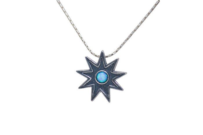 Small silver 9 point star with stone